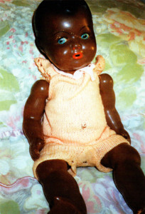Margaret the black china doll, which spent many a night 'sleeping'in the Anderson shelter at the writer's home.