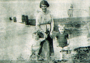 Peggy and her brother at the coast with their mother