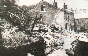 Two cottages demolished when a bomb fell on Hayfield during the 1942 raid.