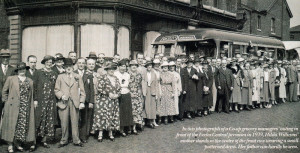In this photograph of a Co-op grocery managers' outing in front of the Eccles Central premises in 1939, Hilda Williams' mother stands in the centre of the front row wearing a small patterned dress. Her father can hardly be seen.
