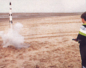 The author's nephew launches a model rocket on Southport beach. With electric ignition and tracking these fly every time, unlike those of the early 1960s.