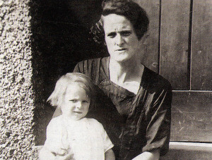 Granny Hunts and daughter Rose sitting on the steps in front of their home.