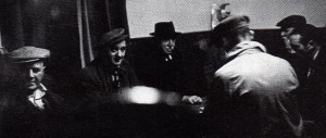 Dominoes in the tap room of the Crown Inn. From left are Jim Lomas, Tom Fletcher, Bill Berrisford and Herbert Jennings.